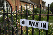 The way in to the polling station on the morning of the UK 2017 general elections outside tSt. Saviours Parish Hall in Herne Hill, Lambeth, on 8th June 2017, in London, England.