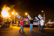 Feb. 22. 2014, The United Steelworkers ( SW) strike for the second night in Norco Louisiana at refineries run by Motiva and Shell. The sky was illuminated by a flare at the Shell Refinery. The strike is part of a nationwide strike that is in its fourth week.