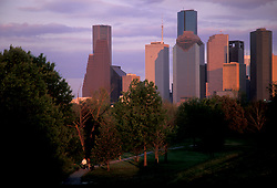 Stock photo of people taking a walk down a path through the park near downtown Houston Texas