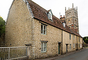 Historic row of cottages and church tower, Calne, Wiltshire, England, UK