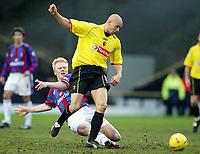 Photo: Scott Heavey.<br />Watford v Crystal Palace. Nationwide Division One. 17/01/2004.<br />Aki Riihilahti Slids in on Gavin Mahon