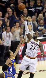The Cleveland Cavaliers' LeBron James (23) puts up a first-quarter shot as the Golden State Warriors' Shaun Livingston defends during Game 4 of the NBA Finals at Quicken Loans Arena in Cleveland on Friday, June 9, 2017. (Photo by Phil Masturzo/Akron Beacon Journal/TNS) *** Please Use Credit from Credit Field ***