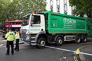 Police cordon of an area at Aldwych where an accident has occurred where a member of the public was hit by a rubbish truck in London, England, United Kingdom.