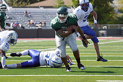 17 September 2011: Kevin Glock falls to the wayside as Sean Conley continues up the field during an NCAA Division 3 football game between the Aurora Spartans and the Illinois Wesleyan Titans on Wilder Field inside Tucci Stadium in.Bloomington Illinois.
