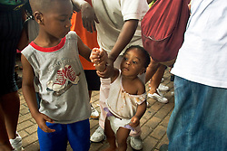 01 Sept, 2005. New Orleans, Louisiana.<br /> Children make up a considerable number of the thousands of desperate people massed outside the Superdome in the baking heat hoping for a seat on a bus to take them out of town to safety. <br /> Photo©; Charlie Varley/varleypix.com