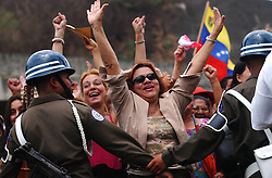 Omaira Matute and other supporters of President Hugo Chavez are held back during one of the President'sspeeches during the inaguration of a government subsidized market called Mercal.