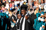 Toby Oladapo, left, and Ronzell Oatman wave to friends and family at Deer Valley High School graduation on Friday, June 8, 2012. (Photo by Kevin Bartram)