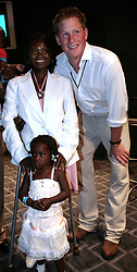 File photo dated 30/06/97 of Prince Harry standing with Eufrafina, 3 and her mother Sandra Tigica. The Duke of Sussex met Sandra Tigica again on day five of the royal tour of Africa, recalling when Princess Diana met on her visit to Angola in 1997.
