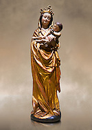 Gothic wooden statue of Madonna and Child from Bohemia, circa 1530-1540, tempera and gold leaf on wood,.  National Museum of Catalan Art, Barcelona, Spain, inv no: MNAC  65506. Against a art background. .<br /> <br /> If you prefer you can also buy from our ALAMY PHOTO LIBRARY  Collection visit : https://www.alamy.com/portfolio/paul-williams-funkystock/gothic-art-antiquities.html  Type -     MANAC    - into the LOWER SEARCH WITHIN GALLERY box. Refine search by adding background colour, place, museum etc<br /> <br /> Visit our MEDIEVAL GOTHIC ART PHOTO COLLECTIONS for more   photos  to download or buy as prints https://funkystock.photoshelter.com/gallery-collection/Medieval-Gothic-Art-Antiquities-Historic-Sites-Pictures-Images-of/C0000gZ8POl_DCqE