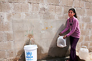 Jordan. Zaatari Camp for Syrian Refugees. Qamar collecting water.