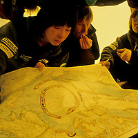 INTERNATIONAL ARCTIC PROJECT. Expedition members plot most efficient route across drifting ice between North Pole and Ellesmere Island.