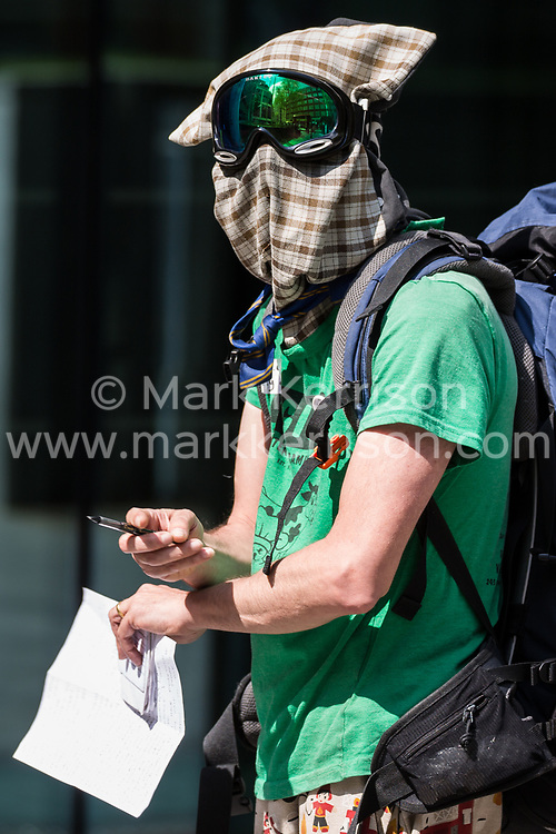 London, UK. 30th April 2019. A climate change activist from Extinction Rebellion stands outside the Home Office during a meeting with fellow activists hosted by the Secretary of State Michael Gove. Credit: Mark Kerrison/Alamy Live News