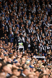 Fans hold scarves for Leicester City Chairman Vichai Srivaddhanaprabha during the Premier League match at the King Power Stadium, Leicester.