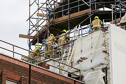 © Licensed to London News Pictures. 07/01/2020. London, UK. Fire-fighters examines the damage of KoKo's roof  following the fire on Monday 6 January. The fire-fighters brought the fire under control at about 02:30am on Tuesday 7 January 2020. Photo credit: Dinendra Haria/LNP