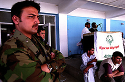 During the closing day of SOA's games, officers from the Afghan National Army are in charge at the Gazhi Stadium.....SPECIAL OLYMPICS AFGHANISTAN 2005 GAMES FOR DISABLES KABUL 25 August 2005.  Gazhi Stadium. On 23-25 August 2005, Special Olympics Afghanistan held its first national Games at Olympic Stadium in Kabul. More than 300 athletes, including 80 female athletes, experienced a taste of happiness and achievement for the first time in their lives. They competed in athletics, bocce and football (soccer). Because of cultural restrictions, males and females competed at separate venues.