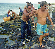 Weak after his failed attempt, a man needed help walking on the lava-like beach. While more than 37,000 rafters were successful in their exodus, it is unknown how many had to turn back or died in the Florida Straits during the summer of 1994.