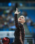 Alina Maksimenko during final at ball in the Pesaro World Cup at the Adriatic Arena in Pesaro, Italy on 28 April 2013.<br /> Alina is an Ukrainian individual rhythmic gymnast. She was born July 10, 1991 in Zaporizhia, Ukraine.
