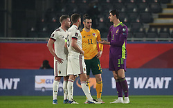 LEUVEN, BELGIUM - Wednesday, March 24, 2021: Wales' captain Gareth Bale chats with Belgium's Thomas Vermaelen (L), captain Jan Vertonghen and goalkeeper Thibaut Courtois (R) after the FIFA World Cup Qatar 2022 European Qualifying Group E game between Belgium and Wales at the King Power Den dreef Stadium. Belgium won 3-1. (Pic by Vincent Van Doornick/Isosport/Propaganda)