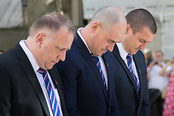 Whitehall, London, August 28th 2015.  Six wreaths are laid at the Cenotaph by representatives from the Armed Forces, the RFL, the Parliamentary Rugby League Group and Ladbrokes Challenge Cup finalists Hull Kingston Rovers and Leeds Rhinos, ahead of Saturday's Ladbrokes Challenge Cup Final at Wembley. PICTURED: Hull KR's representatives including Chief Executive Mike Smith (L) and club captain Terry Campese (C) bow their heads after laying their wreath.