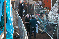 London, UK. 26th February, 2019. Bailiffs from the National Eviction Team evict residents of Grow Heathrow, a squatted eco-community founded in 2010 on a previously derelict site close to Heathrow airport in protest against government plans for a third runway. The community has since developed an extensive garden and is acknowledged to have made a significant educational and spiritual contribution to life in the Heathrow villages which are threatened by airport expansion. Bailiffs have almost secured the front section of the site, owned by Imran Malik, removing several protesters locked on in towers above the camp, but four protesters are believed to remain in a tunnel beneath that area. Many more protesters remain on the rear portion of the site. Five legal challenges to the government's approval of a 3rd runway at Heathrow will proceed to judicial review at the Royal Courts of Justice on 10th March.