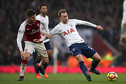 Tottenham Hotspur's Christian Eriksen (right) is held back by Arsenal's Shkodran Mustafi (left)