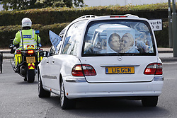© Licensed to London News Pictures. 21/08/2018. Epsom, UK. The funeral cortege of traveller Mikey Connors makes it's way to the cemetery for a burial service. 32 year-old Mikey Connors, the nephew of My Big Fat Gypsy Wedding star Paddy Doherty, was killed when his horse-and-cart was hit by a car in Thamesmead on July 28. Photo credit: Peter Macdiarmid/LNP