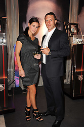 Kirsty Gallacher and PAUL SAMPSON at a party to celebrate 150 years of TAG Heuer held at the car park at Selfridge's, London on 15th September 2010.