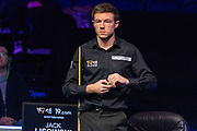 Jack Lisowski nervously picks at the paper on his chalk while Mark Selby is at the table during the first session of  the World Snooker 19.com Scottish  Open Final Mark Selby vs Jack Lisowski at the Emirates Arena, Glasgow, Scotland on 15 December 2019.