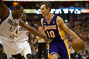 Steve Nash (10) of the Los Angeles Lakers drives the ball past Elton Brand (42) of the Dallas Mavericks at the American Airlines Center in Dallas on Sunday, February 24, 2013. (Cooper Neill/The Dallas Morning News)