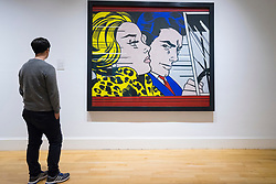 Man looking at painting, In the Car, by Roy Lichtenstein on display at Scottish National Gallery of Modern Art in Edinburgh, Scotland, United Kingdom