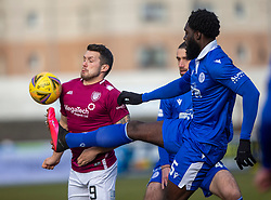 06MAR21 Arbroath's David Hilson and Queen of the South's Ayo Obileye. Arbroath 2 v 4 Queen of the South, Scottish Championship played 6/3/2021 at Arbroath's home ground, Gayfield Park.