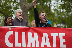 London, UK. 1st May, 2019. Anna Taylor of UK Student Climate Network addresses climate protesters at a Declare A Climate Emergency Now demonstration in Parliament Square organised to coincide with a motion in the House of Commons to declare an environment and climate emergency tabled by Leader of the Opposition Jeremy Corbyn. The motion, which does not legally compel the Government to act, was passed without a vote.