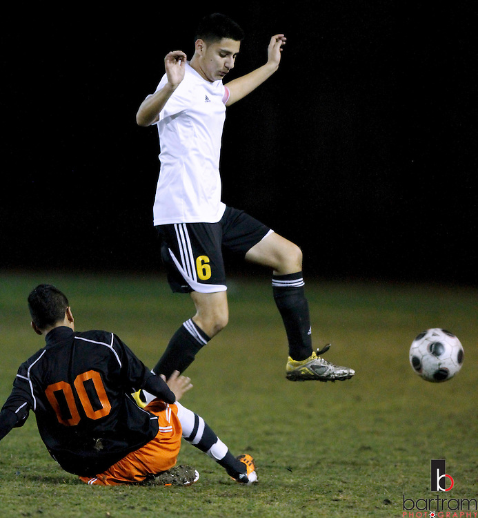 Antioch High's Steven Ibanez (6) gets the ball away from Pittsburg High's Isreal Murgia during their game at Antioch High School on Tuesday, Feb. 7, 2012. (Photo by Kevin Bartram)