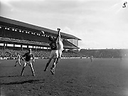 22/04/1962<br /> 04/22/1962<br /> 22 April 1962<br /> Gaelic Weekly S.F. Tournament final, Kildare v. Meath<br /> Kildare's P. Maguire fists the ball past Meath defender M. Quinn during the final at the Gaelic Weekly S.F. Tournament at Croke Park, Dublin, on 22 April 1962.