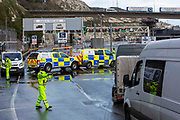 Police manage the traffic into the port as tensions are high between them and drivers who have been waiting over 48 hours for the Port of Dover to re-open, on the 23rd of December 2020, Dover, Kent, United Kingdom. The French border was closed due to a new strain of COVID-19 all travellers are now waiting to receive a COVID-19 test before they can board a ferry to Calais, France. Dover is the nearest port to France with just 34 kilometres 21 miles between them. It is one of the busiest ports in the world. As well as freight container ships it is also the main port for P&O and DFDS Seaways ferries.