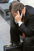distressed businessman on cell phone