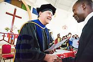 The Rev. Dr. Lawrence R. Rast, Jr., president of Concordia Theological Seminary, Fort Wayne, Ind., presents a certificate of accomplishment to a graduating pastoral student on Saturday, March 14, 2015, at the Evangelical Lutheran Church in Tanzania – South-East of Lake Victoria Diocese's (ELCT-SELVD) Ebenezer Cathedral in Shinyanga, Tanzania. LCMS Communications/Erik M. Lunsford
