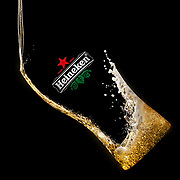 Heineken lager pouring into an invisible pint glass Ray Massey is an established, award winning, UK professional  photographer, shooting creative advertising and editorial images from his stunning studio in a converted church in Camden Town, London NW1. Ray Massey specialises in drinks and liquids, still life and hands, product, gymnastics, special effects (sfx) and location photography. He is particularly known for dynamic high speed action shots of pours, bubbles, splashes and explosions in beers, champagnes, sodas, cocktails and beverages of all descriptions, as well as perfumes, paint, ink, water – even ice! Ray Massey works throughout the world with advertising agencies, designers, design groups, PR companies and directly with clients. He regularly manages the entire creative process, including post-production composition, manipulation and retouching, working with his team of retouchers to produce final images ready for publication.