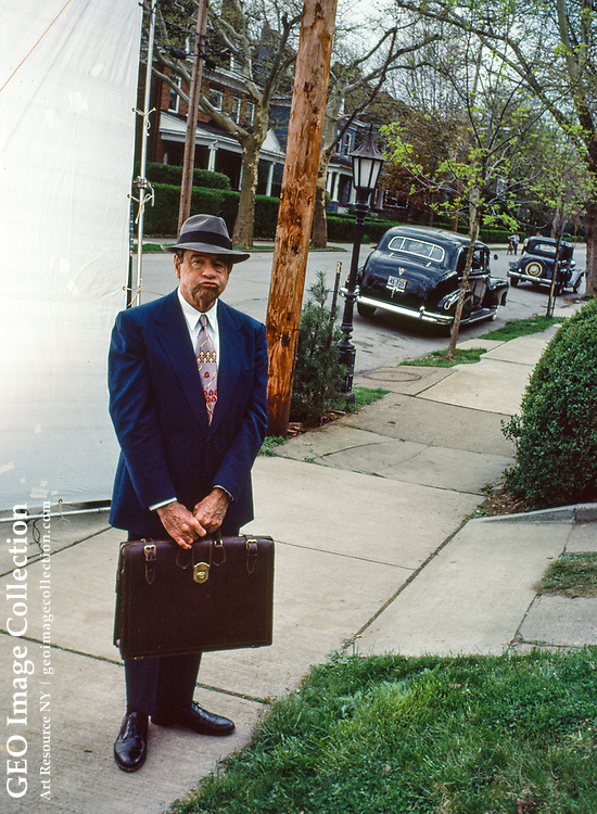 Actor Walter Matthau prepares to appear in a movie named Against Her Will that is being filmed in the Point Breeze affluent residential neighborhood of Pittsburgh. The neighborhood is used as a set for a movie and decorated to appear as it did in the 1930's. Mr. Matthau is dressed in a suit of 1930's retro fashion style for his role as an attorney or lawyer.