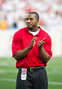 Sep 10, 2011; Little Rock, AR, USA;  Arkansas Razorback and New England Patriots former running back Cedric Cobbs stands on the field before the start of a game against the New Mexico Lobos at War Memorial Stadium. The Razorbacks beat the Lobos 52-3. Mandatory Credit: Beth Hall-US PRESSWIRE