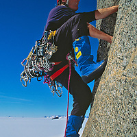 """Conrad Anker free climbs low on the huge overhanging face of Rakekniven (""""The Razor"""") in Queen Maud Land, Antarctica."""