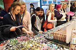 © Licensed to London News Pictures. 28/03/2016. Visitors buying cosmetics at The Professional Beauty Show. The show is the largest in the UK and one of the largest in Europe. London, UK. Photo credit: Ray Tang/LNP