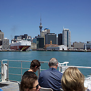 A view of the City of Auckland and Auckland Harbour showing the Sky Tower from the Devonport Ferry. Auckland, North Island, New Zealand. 26th November 2010.