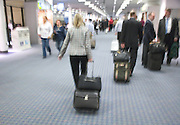 business people walking in an airport terminal hall