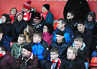 Lincoln City fans watch their team in action<br /> <br /> Photographer Andrew Vaughan/CameraSport<br /> <br /> The EFL Sky Bet League Two - Lincoln City v Northampton Town - Saturday 9th February 2019 - Sincil Bank - Lincoln<br /> <br /> World Copyright © 2019 CameraSport. All rights reserved. 43 Linden Ave. Countesthorpe. Leicester. England. LE8 5PG - Tel: +44 (0) 116 277 4147 - admin@camerasport.com - www.camerasport.com