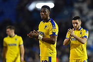 Paul Kalambayi (30) of AFC Wimbledon applauds the travelling fans at full time after a 2-1 loss to Portsmouth during the EFL Sky Bet League 1 match between Portsmouth and AFC Wimbledon at Fratton Park, Portsmouth, England on 1 January 2019.