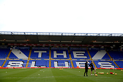 Brentford's coaching staff on the pitch before the match at St Andrew's Trillion Trophy Stadium