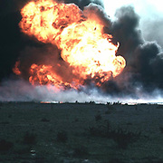 Burning oilfield during Operation Desert Storm, Kuwait   Date Cropped from an undated