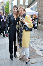 Left to right, ALEXANDRA ECONOMOU and her mother RIKA VOSNIADO at a private view in aid of Chickenshed of Julian Schnabel's first UK solo show of paintings for 15 years entitled 'Every Angel Has A Dark Side' held at the Dairy Art Centre, 7a Wakefield Street, Bloomsbury, London on 24th April 2014.