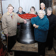 """UK, November 24 2014: Anne and Brian Horrell and others stand next to the new tenor bell that will be installed at All Saints East Budleigh church. The inscription on the bell states """"Anne and Brian Horrell married at All Saints East Budleigh 6th June 1959"""" . Copyright 2014 Peter Horrell."""